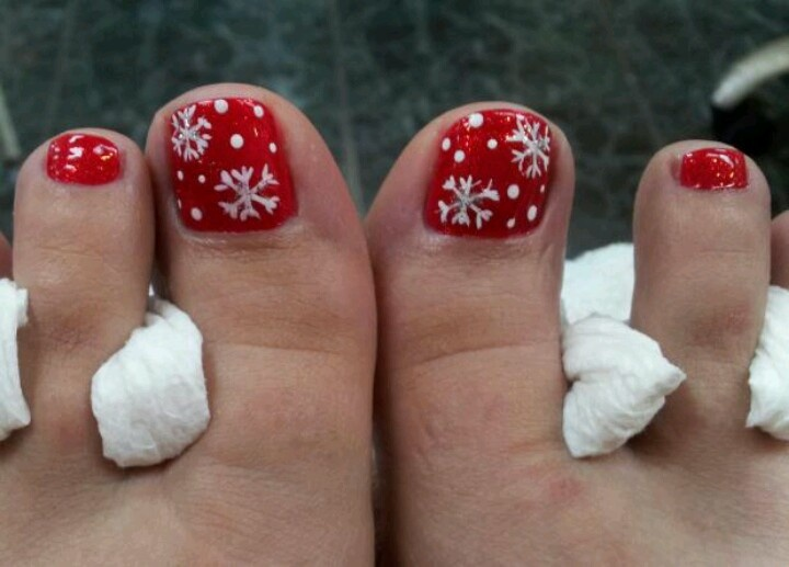 Red with white snowflakes toe nail art