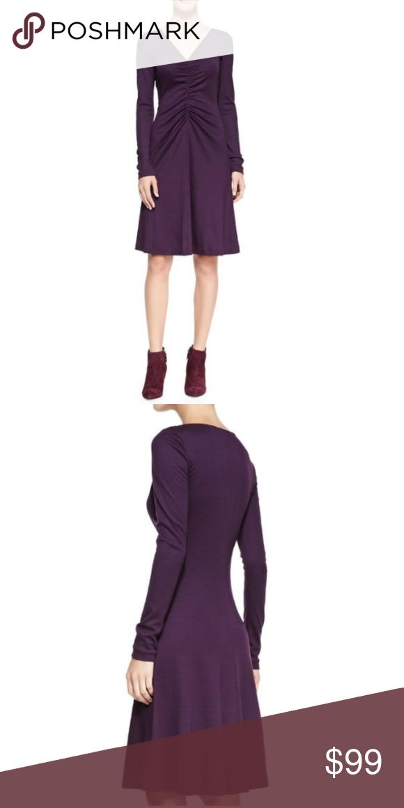 """DVF Long-sleeve Runched A-line Night Out Dress Measurements Taken While Garment is Lying Flat, Unstretched  Size 8: 35"""" bust, 28"""" waist, 44"""" hips, 39"""" total length   MSRP: Unknown  100% Wool  Color: Purple  Long sleeves  Vneck  Ruched down the center front  A-line  Pull over styling  Unlined   Imported   All items stated NWT or NEW are 100% authentic and new. Some items will have tags cut or a black line drawn through the designer name on the tag. This is to prevent retail returns on our…"""