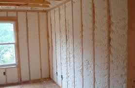 shipping container home house built have used spray on insulation inside between timber studs.