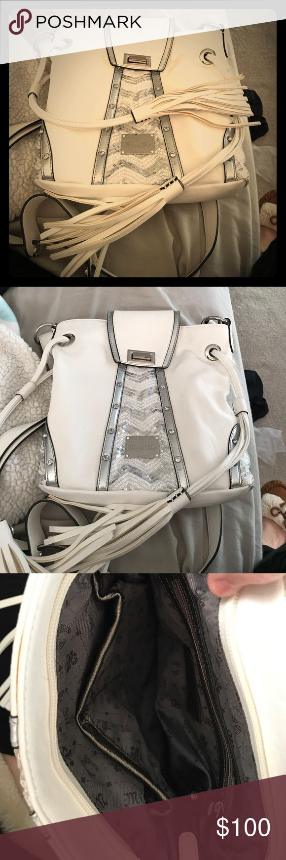 Miss Me purse White sparkly miss me purse. I paid $120. asking $100 but willing to negotiate. It's in excellent condition. Used twice. Miss Me Bags Satchels