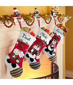 *New*– Winter Wonderland Stockings A Personal Creations Exclusive! Our fanciful felt stocking has a green-and-red striped toe with a matching cuff draped in snow. Choose from an array of beloved winter characters: Santa, Mrs. Claus, Snowman, Moose, Bear, Penguin, Cat or Dog. http://kittykatkoutique.com/new-personalized-christmas-stockings-2015/