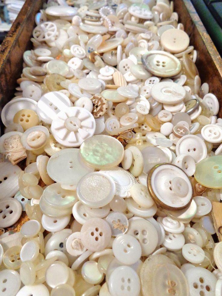 buttons!!  Reminds me of my grandma's White sewing machine drawer! I'd give anything to have it now! <3