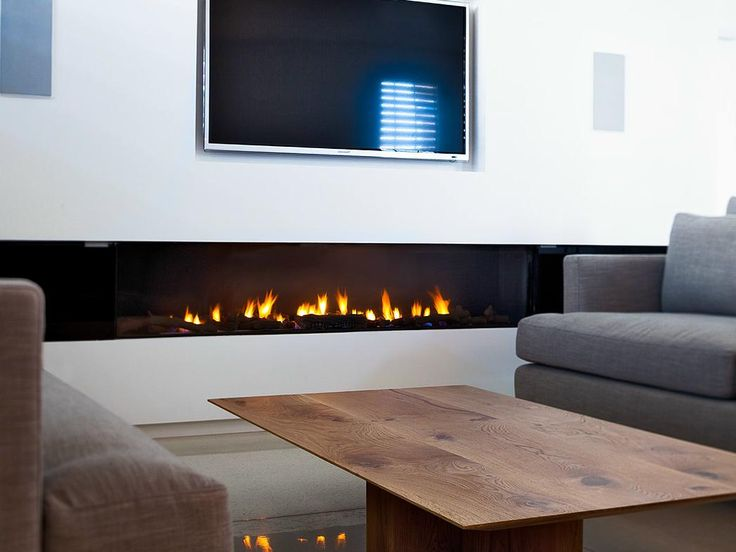 Stunning Rectangular Long Gas Fireplace Design Set Under The Wall Mounted Well Wooden