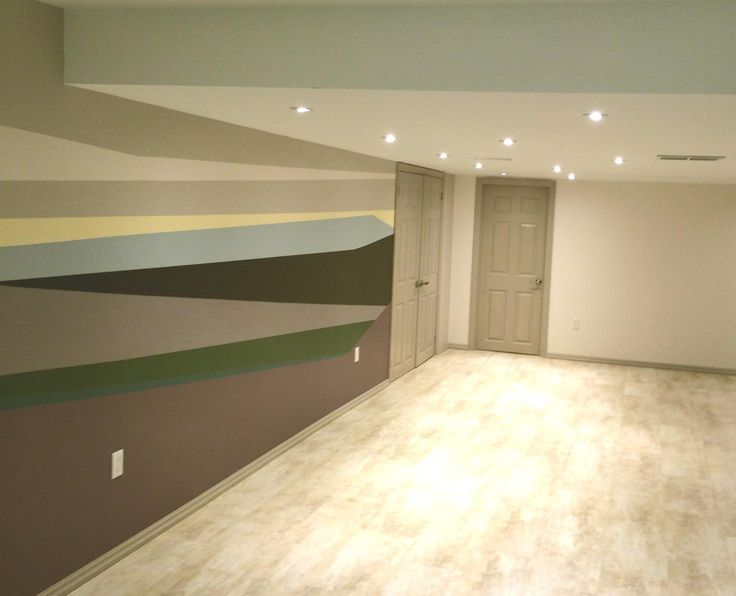 Abstract Wall Mural , painted by my customers daughter , after I created her canvas.  Finished Basement.