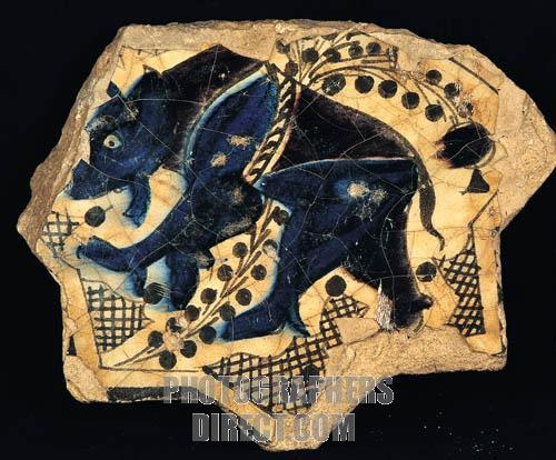 Seljuk tile bear figure A . D . 1236 Kubadabad Palace , Konya Karatay Madrasah Museum . stock photo