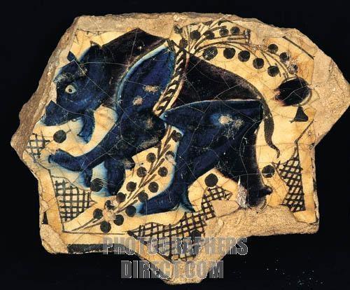 Seljuk tile bear figure A . D . 1236 Kubadabad Palace , Konya Karatay Madrasah Museum . stock photo