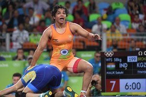 India's Sakshi Malik celebrates after winning against Kirghyzstan's Aisuluu Tynybekova in their women's 58kg freestyle bronze medal match on August 17, 2016, during the wrestling event of the Rio 2016 Olympic Games at the Carioca Arena 2 in Rio de Janeiro. / AFP PHOTO / Toshifumi KITAMURATOSHIFUMI KITAMURA/AFP/Getty Images