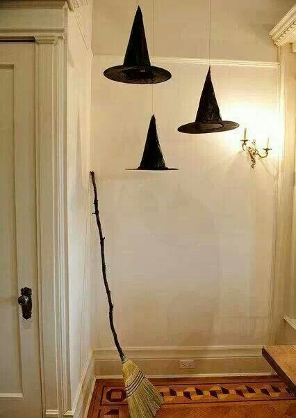 Halloween floating witch hats and a broom. love this...would do it with more hats and a cool background.