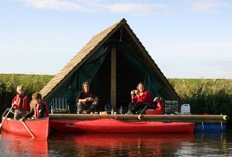 creative houseboat with canoes, platform & roof