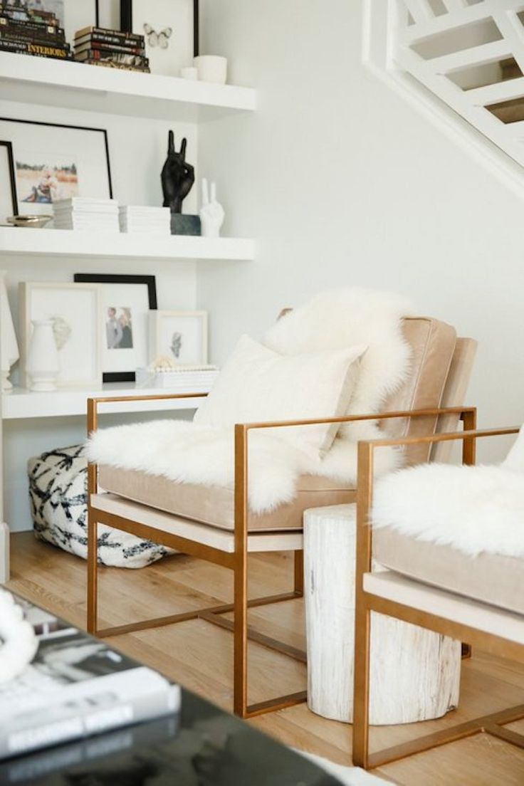 Gold frame sitting chairs with neutral cushions by Nicole Davis