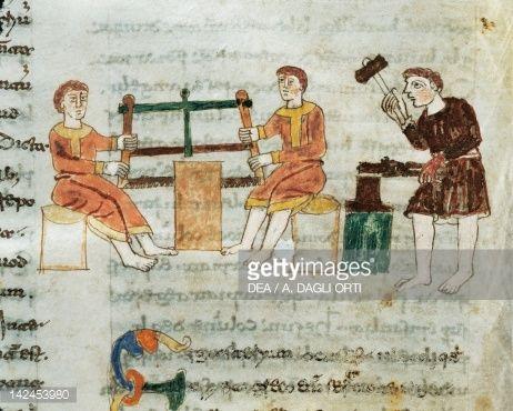 Stock Illustration : Carpenter and blacksmith, miniature from De universo by Rabano Mauro, manuscript, Italy 11th Century.