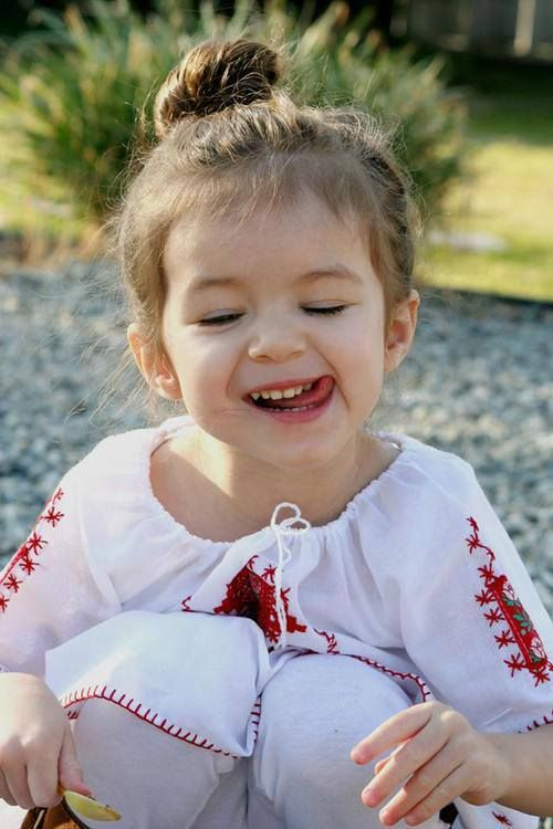 Cute Romanian girl wearing the traditional blouse IA!
