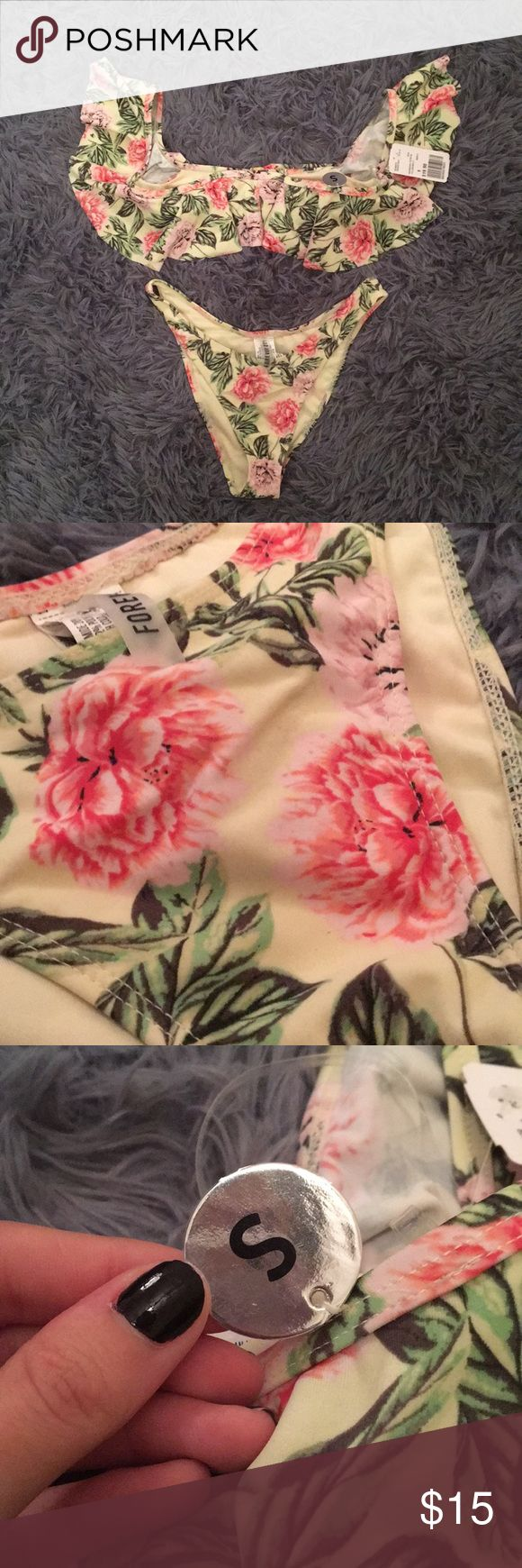 Forever 21 off the shoulder floral bathing suit. Forever 21 off the shoulder floral pattern bathing suit. Top and bottom both size small. Forever 21 Swim Bikinis