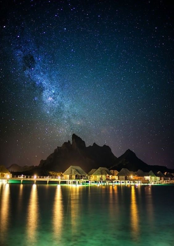 Amazingnight in Bora Bora, French Polynesia by Trey Ratcliff ..... Bora Bora is an atoll in the Society Islands, part of French Polynesia, located northwest of Tahiti, about 260 km northwest of Papeete. It has an area of 29.3 square kilometers and consists of an extinct volcano surrounded by a lagoon separated from the sea by a reef. The highest point is Mount Otemanu to 727 meters. The island is surrounded by motus, which are small elongated islands which usually have a certain width…