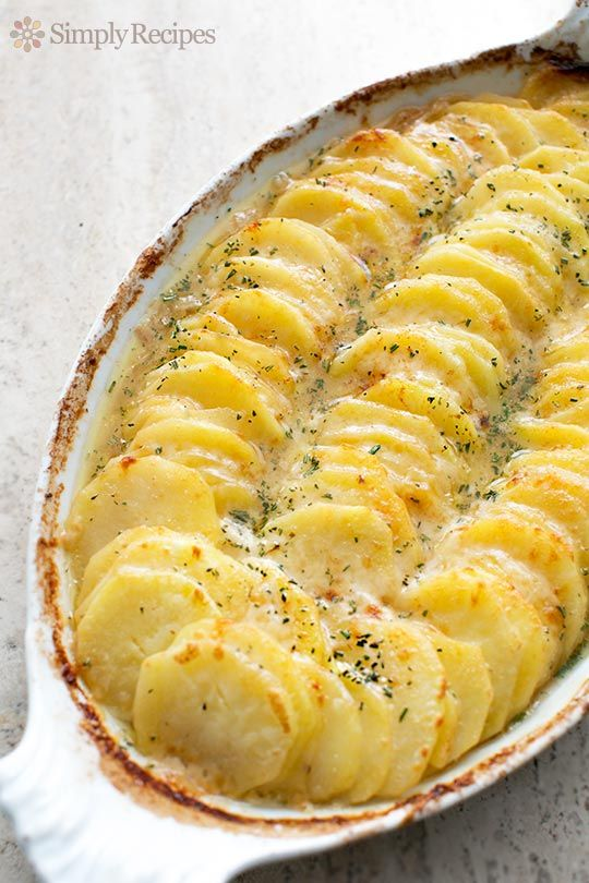 Scalloped Potatoes with Caramelized Onions and Gruyere ~ Gorgeous scalloped potatoes with caramelized onions, Gruyere and Parmesan cheeses. Perfect for holiday entertaining! ~ SimplyRecipes.com
