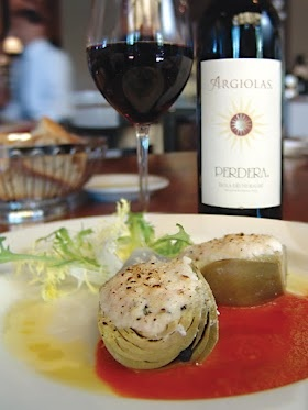 "Il Fornaio - ""Carciofi Ripieni di Ricotta"" - roasted artichokes stuffed with ricotta, pecorino, sausage and mint; served with marinara and frisee with lemon-infused extra-virgin olive oil. Pairs perfectly with Perdera Argiolas wine."
