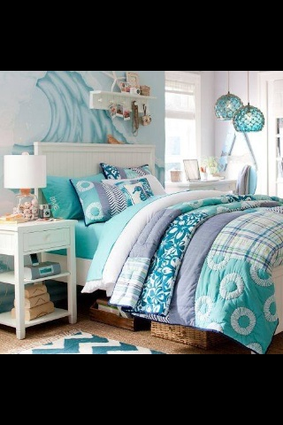 Cute beach bedroom but love the glass lamps on right