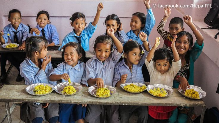 Food for Life in Nepal. Kids getting a healthy vegan lunch.