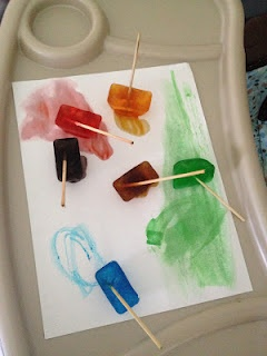 ice cube painting, love the addition of popsicle sticks so that kids' hands don't get cold!