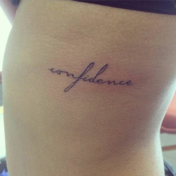 "Side tattoo saying ""confidence""."