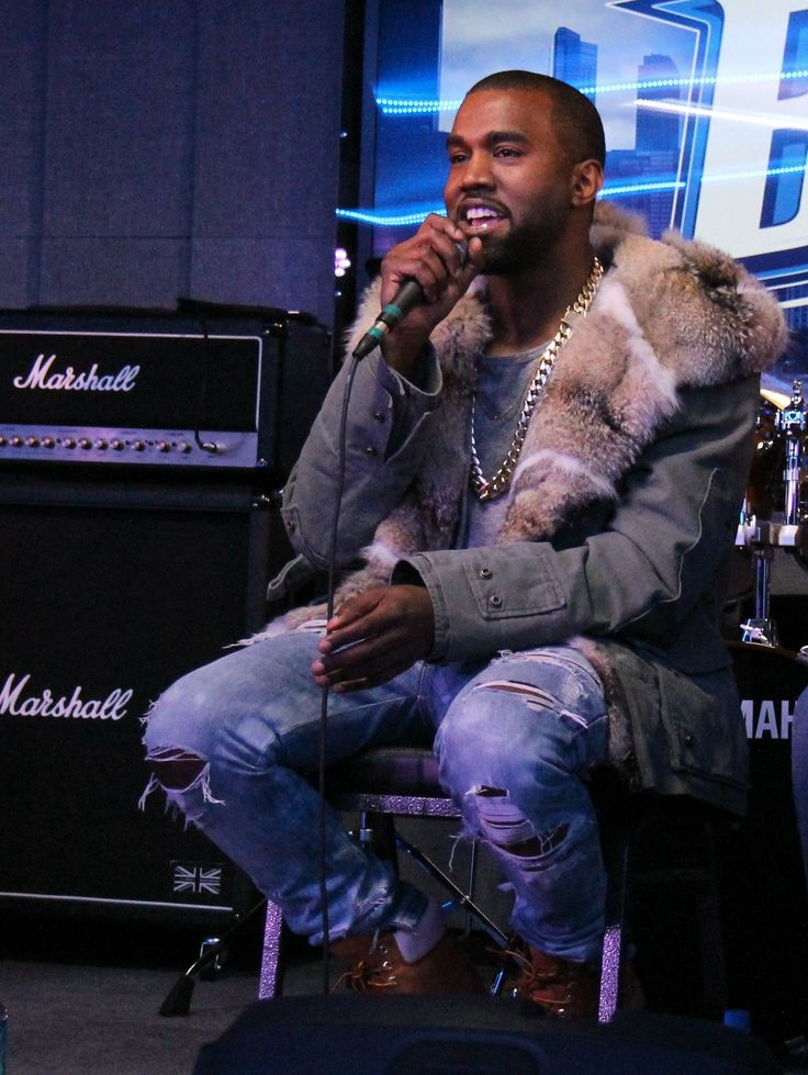 Kanye West December 2013: ripped denim + military jacket w fur collar + crew + gold chain + Timbs