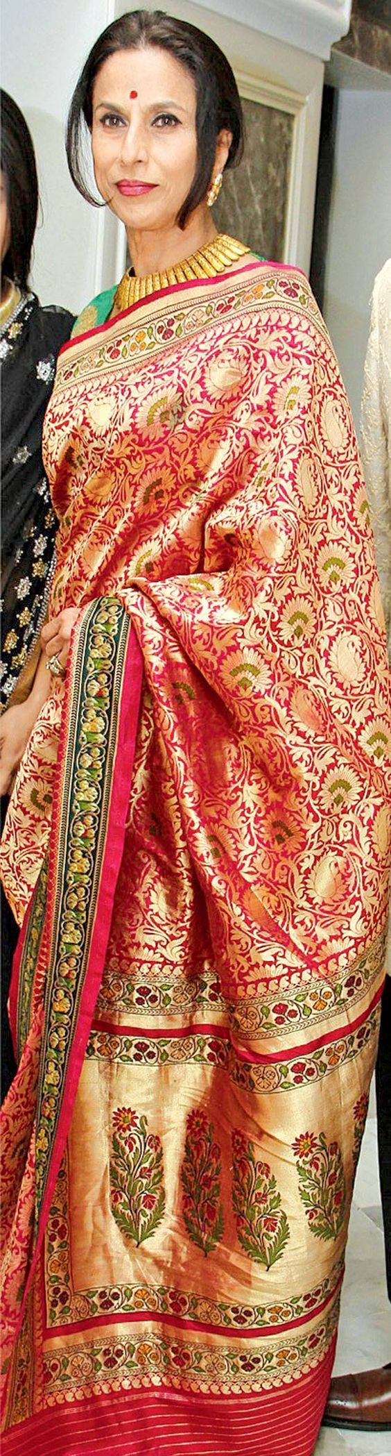 Shoba Dey in gold banaras saree
