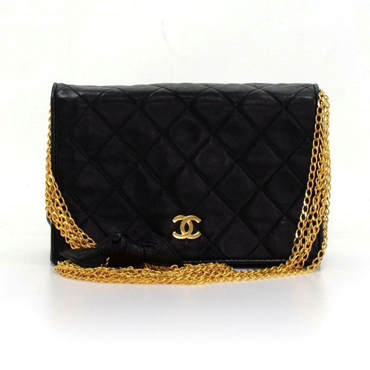 Authentic vintage Chanel bag in black quilted leather. Flap top with CC logo stud closure in front. Inside has leather lining and 1 zipper pocket. It can be used as clutch or shoulder bag. Wonderful statement bag wherever you go! Very rare item to find. #Chanel #Handbag @fmasarovic