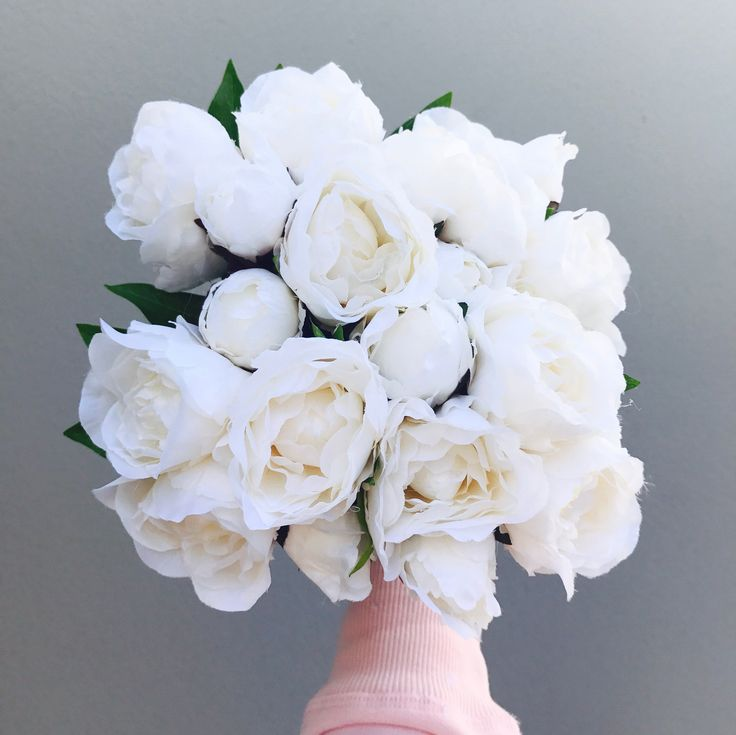 Premium artificial silk peonies. These stunning white flowers are the 2017 new release with a hard centre so the flowers wont collapse. These will keep their shape forever! 5 stems per bouquet including three open blooms and two buds with foliage . Approximately 24cm in height. *Image shows four bouquets.