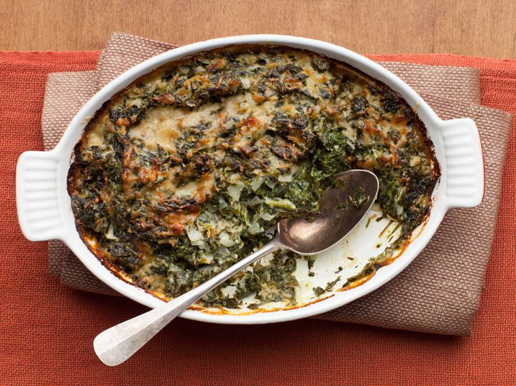 Ina's Spinach Gratin Recipe. I double the cheese suggested. The first batch of cheese completely goes in the spinach mixture…. the second batch goes on top. I have made this so many years just like this. Make sure you squeeze every living drop of water out of the spinach or else it will get watery.