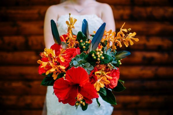 Your Unique Winter Wedding Needs These 10 Crazy Cool Colors | Turn up the temps of your winter wedding with some fiery red hibiscus wedding bouquets. Your first kiss as a wedded couple won't be the only thing warming your guests' hearts!
