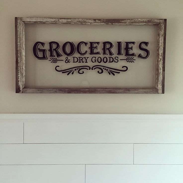 Wood window hand painted to look like a vintage grocery sign