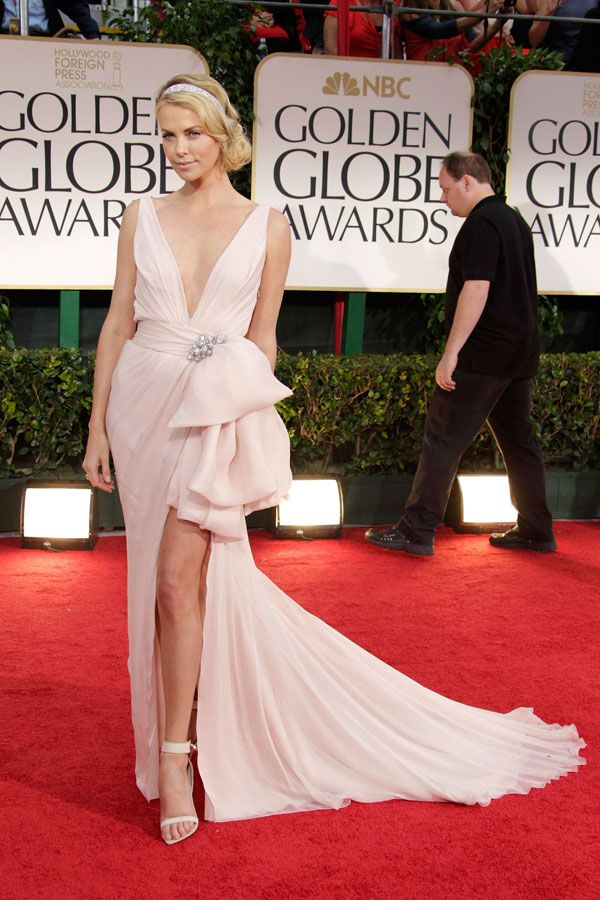 20 Best Golden Globes Dresses - Most Memorable Dresses from Golden Globes Past - Cosmopolitan:  Charlize Theron, 2012. Perfect. Just perfect. The actress paired her Dior dress with Cartier jewelry and Givenchy shoes.