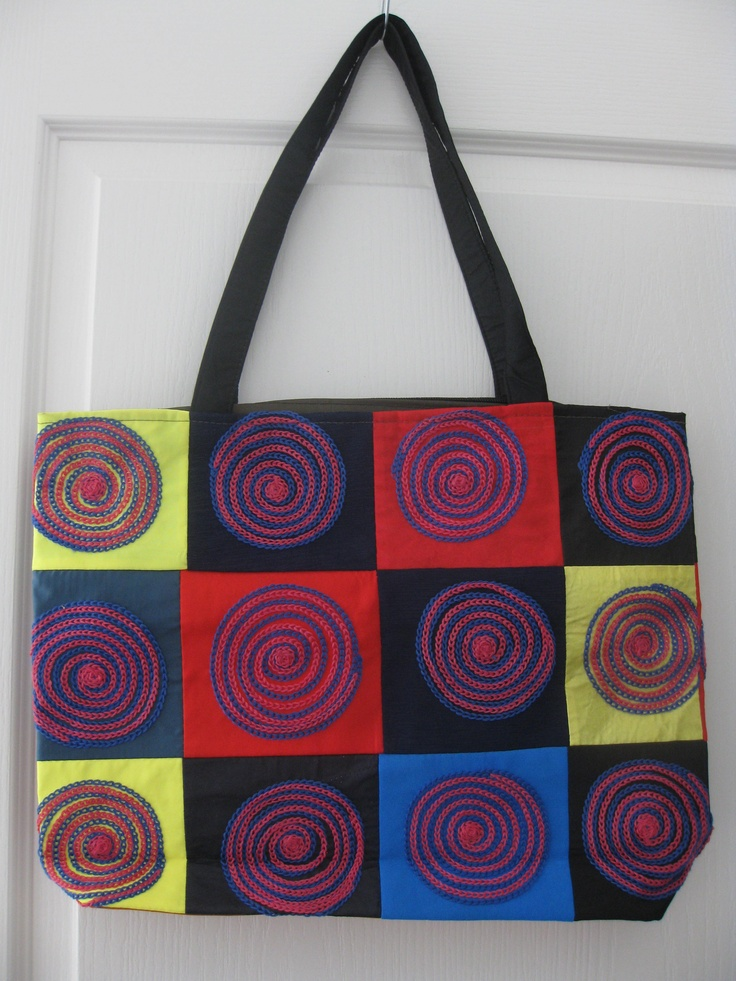 Fabric patwork handbag with cotton stitching.  Double-sided.  Fully lined with zippered closure and smaller zippered inside pocket.  View more at www.facebook.com/vshandbagsandaccessories and to learn about shipping. $20