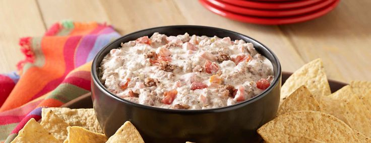 A warm appetizer recipe of crumbled sausage, zesty tomatoes and cream cheese combined for a dip to serve with chips. Philadelphia® is a registered trademark of Kraft Foods Inc.