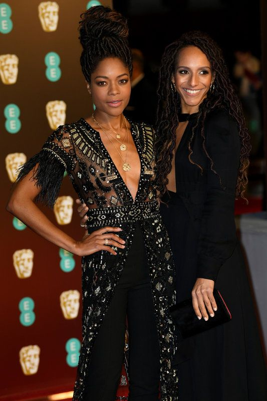 (Doug Peters/EMPICS Entertainment) Photos From The Baftas Red Carpet: Naomie Harris with Afua Hirsch attending the EE British Academy of Film awards (BAFTA) at the Royal Albert Hall, London 20180218