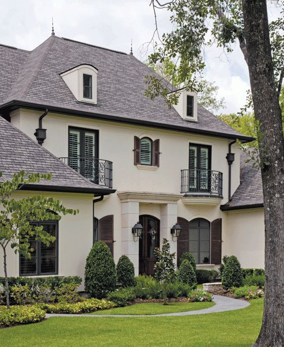 Brick may be all the rage now, but I'll always love a house with that 'French Country appeal.