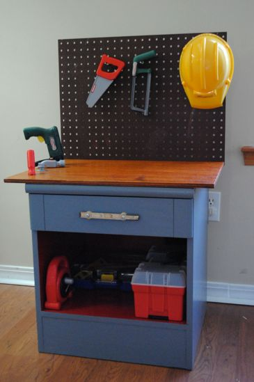 Toy Workbench from a Nightstand ~ This darling workbench was made from a nightstand picked up at a thrift store for $3!  For that price, you could buy a set of play tools to go with it and you'd have a perfect birthday or Christmas gift for the little builder in you life. (I even have an old nightstand!)