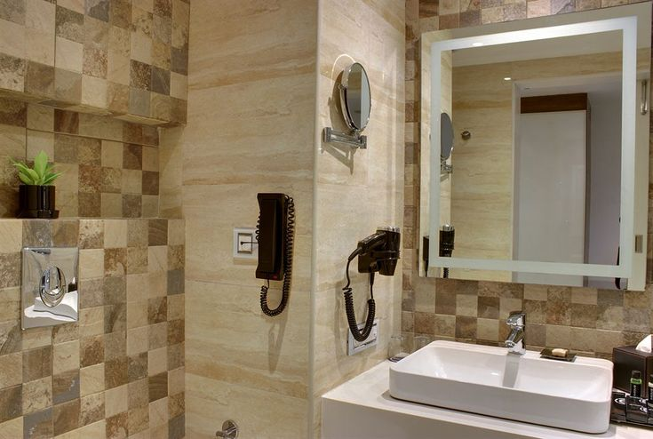 Ramada encore bangalore domlur check out the tiles for Small bathroom designs bangalore