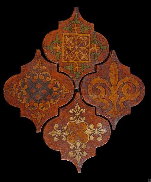Decorated arabesque terracotta tiles by Ken Mason Tiles. Handmade tiles can be colour coordinated and customized re. shape, texture, pattern, etc. by ceramic design studios