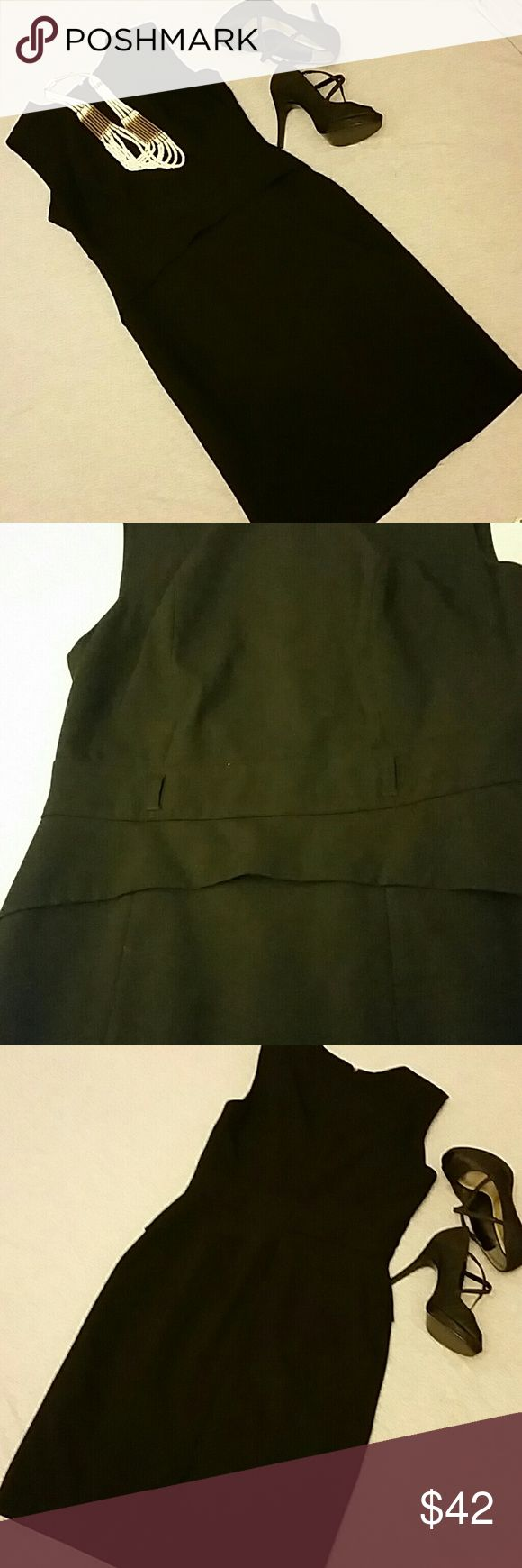 Calvin Klein LBD size 4 Dress is sized as a 6 but fits like a 4. Waist detail and loops for belt if desired. Classy for work or after work drinks.  Measures 39.5 inches from shoulder to bottom hem, 16 inches armpit to armpit. Calvin Klein Dresses Midi