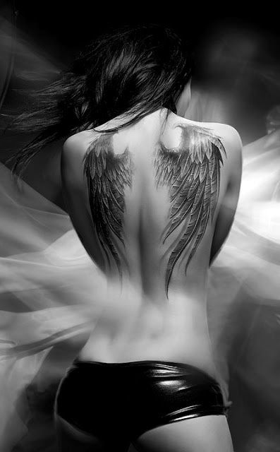 Black and white Angel's wing tattoo on back of body