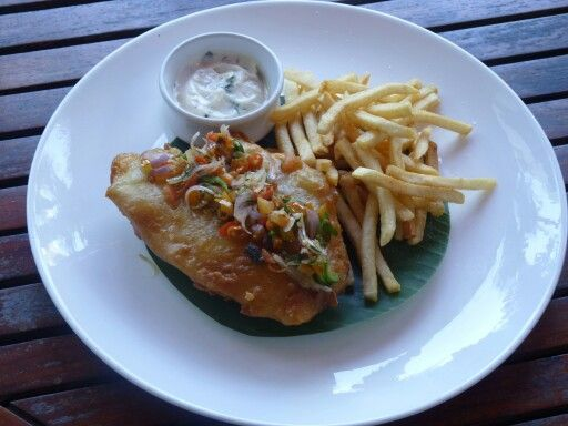"Balinese Fish and Chip - Fried fish with Balinese salsa ""sambal matah"" served with french fries."
