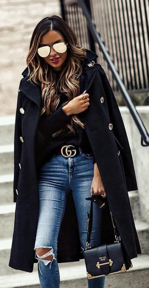 #winter #outfits black long coat and distressed blue denim fitted jeans