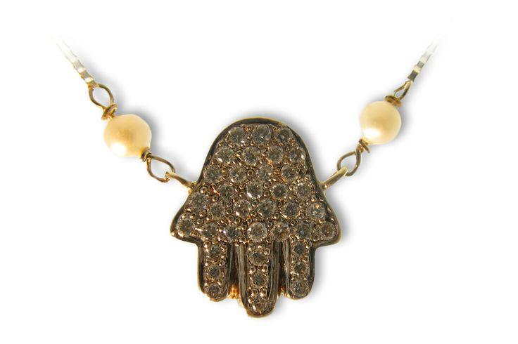 18 karat gold and diamond 'Hamsa' designer pendant.
