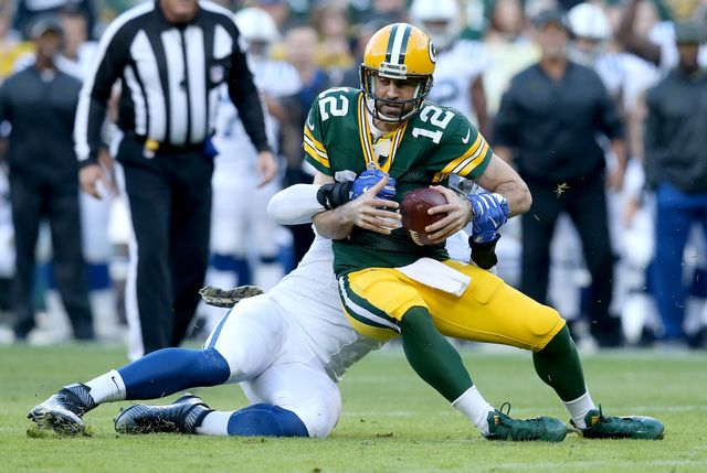 GREEN BAY, WI - NOVEMBER 06: Lavar Edwards #95 of the Indianapolis Colts sacks Aaron Rodgers #12 of the Green Bay Packers in the first quarter at Lambeau Field on November 6, 2016 in Green Bay, Wisconsin. (Photo by Dylan Buell/Getty Images)