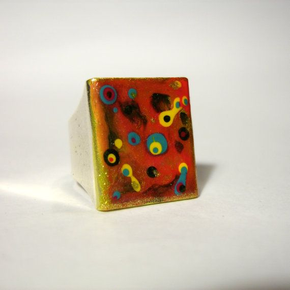 Check out this item in my Etsy shop https://www.etsy.com/listing/246626109/orange-square-ring-with-macro-mineral