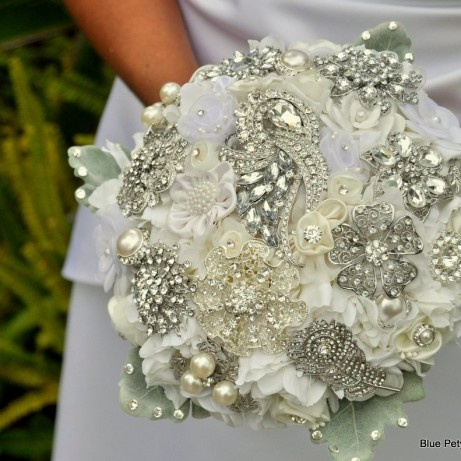 My Aunt introduced me to this idea...an antique brooch bouquet...it definitely has a unique and beautiful appeal, but there is something to be said for real flowers...