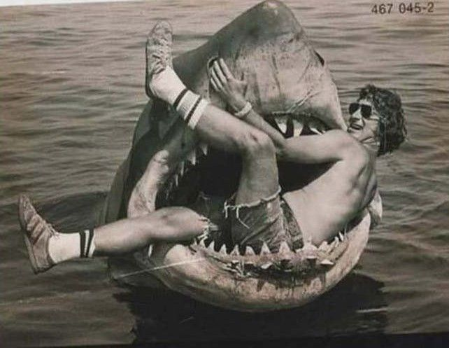 Steven Spielberg sits in the mouth of the mechanical shark used in his movie, Jaws.
