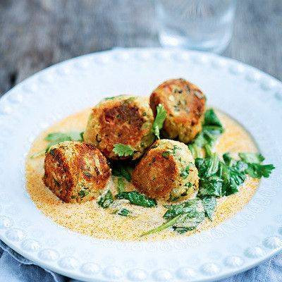 lentil balls with red curry sauce.