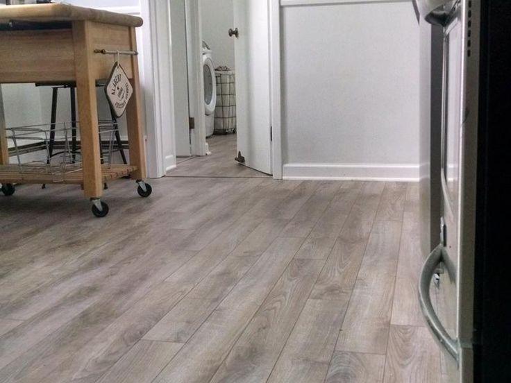 Before and after lumber liquidators delaware bay for Laminate flooring de